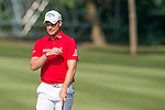 Danny Willett of England (in red) during the 58th UBS Hong Kong Golf Open as part of the European Tour on 11 December 2016, at the Hong Kong Golf Club, Fanling, Hong Kong, China. Photo by Marcio Rodrigo Machado / Power Sport Images