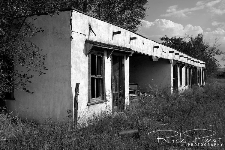 The ruins of a 4 room motel along Route 66 in Newkirk, New Mexico still stand.