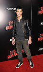 HOLLYWOOD, CA. - March 11: Taylor Lautner arrives at the Los Angeles Premiere of The Runaways at ArcLight Cinemas Cinerama Dome on March 11, 2010 in Hollywood, California.