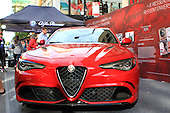 A new red Alfa Romeo on display during the Grand Prix weekend event in downtown Montreal