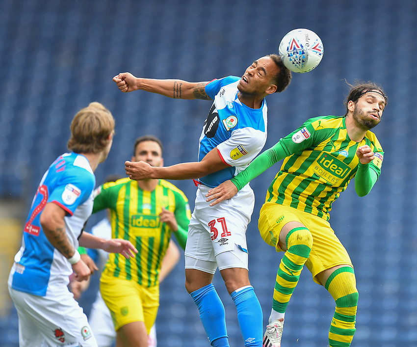 Blackburn Rovers' Elliott Bennett battles with West Bromwich Albion's Filip Krovinovic<br /> <br /> Photographer Dave Howarth/CameraSport<br /> <br /> The EFL Sky Bet Championship - Blackburn Rovers v West Bromwich Albion - Saturday 11th July 2020 - Ewood Park - Blackburn <br /> <br /> World Copyright © 2020 CameraSport. All rights reserved. 43 Linden Ave. Countesthorpe. Leicester. England. LE8 5PG - Tel: +44 (0) 116 277 4147 - admin@camerasport.com - www.camerasport.com