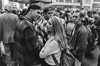 Pretty girl attracts attention of  guys at NYC St. Patrick's Day parade.<br />