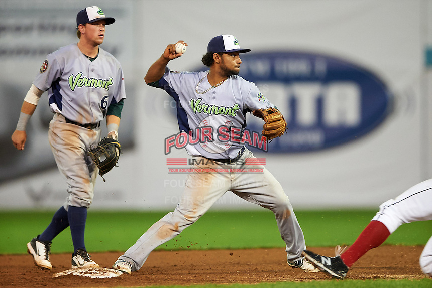 Vermont Lake Monsters second baseman Jesus Lopez (2) throws to first as Trace Loehr (6) looks on during the second game of a doubleheader against the Batavia Muckdogs August 11, 2015 at Dwyer Stadium in Batavia, New York.  Batavia defeated Vermont 1-0.  (Mike Janes/Four Seam Images)