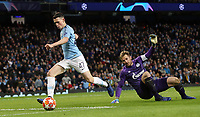 Manchester City's Phil Foden rounds FC Schalke 04's Ralf Fahrmann on his way to scoring his sides seventh goal <br /> <br /> Photographer Rich Linley/CameraSport<br /> <br /> UEFA Champions League Round of 16 Second Leg - Manchester City v FC Schalke 04 - Tuesday 12th March 2019 - The Etihad - Manchester<br />  <br /> World Copyright © 2018 CameraSport. All rights reserved. 43 Linden Ave. Countesthorpe. Leicester. England. LE8 5PG - Tel: +44 (0) 116 277 4147 - admin@camerasport.com - www.camerasport.com