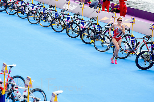 04 AUG 2012 - LONDON, GBR - Paula Findlay (CAN) of Canada runs through transition for the start of another lap during the women's London 2012 Olympic Games Triathlon in Hyde Park in London, Great Britain (PHOTO (C) 2012 NIGEL FARROW)