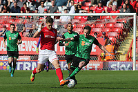 Michal Zyro of Charlton Athletic and Scunthorpe's Josh Morris challenge for the ball during Charlton Athletic vs Scunthorpe United, Sky Bet EFL League 1 Football at The Valley on 14th April 2018