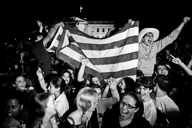 A crowd builds in front of the White House to cheer the news on Sunday night, May 1, 2011, that Osama Bin Laden had been killed by US military forces. President Barack Obama addressed the nation from the White House to announce the news.