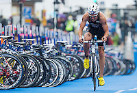26 AUG 2012 - STOCKHOLM, SWE - Steffen Justus (GER) of Germany  rides through transition at the start of his final bike lap during the 2012 ITU Mixed Relay Triathlon World Championships in Gamla Stan, Stockholm, Sweden (PHOTO (C) 2012 NIGEL FARROW)