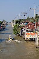 Long tail boat in canal near Damnoen Saduak Floating Market, Damnoen Saduak, Thailand