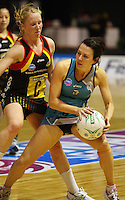 Thunderbirds captain Natalie Von Bertouch is pressured by Laura Langham during the ANZ Netball Championship match between the Waikato Bay of Plenty Magic and Adelaide Thunderbirds, Mystery Creek Events Centre, Hamilton, New Zealand on Sunday 19 July 2009. Photo: Dave Lintott / lintottphoto.co.nz