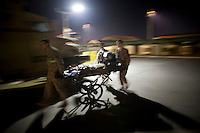 Hospital staff rush a patient from the US Army medevac helicopter landing pad into Bagram's SSG Heath N. Craig Joint Theatre Hospital.
