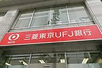 A signboard of Bank of Tokyo-Mitsubishi UFJ on display outside its bank branch on May 17, 2017, Tokyo, Japan. Japan's biggest bank plans to shorten its name by dropping ''Tokyo'' to Bank of Mitsubishi UFJ. (Photo by Rodrigo Reyes Marin/AFLO)
