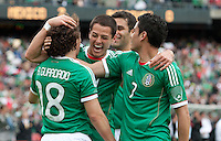 Andres Guardado (18) celebrates his goal with Javier Hernandez (center) and Pablo Barrera (7). Mexico defeated Paraguay 3-1 at the Oakland Coliseum in Oakland, California on March 26th, 2011.