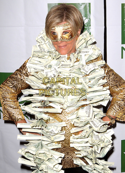 SUZE ORMAN.13th Annual Bette Midler's New York Restoration Project's Hulaween Gala held at the Waldorf-Astoria, New York, NY, USA..October 31st, 2008.half length money cash bills dollars hands on hips brown  dress-up costume.CAP/ADM/PZ.©Paul Zimmerman/AdMedia/Capital Pictures.