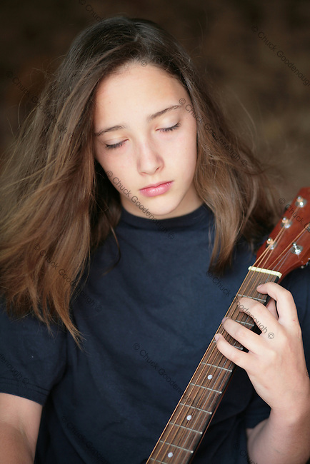 Stock Photo of a Rock and Roll Girl With Her Acoustic Guitar