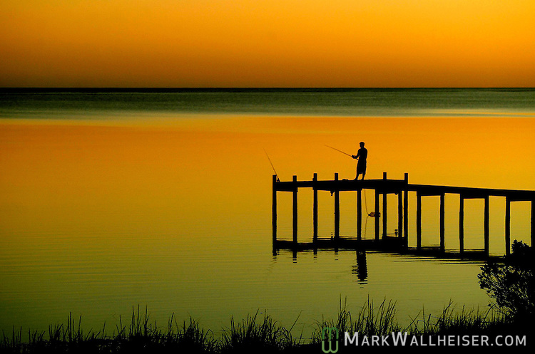 A fisherman enjoys the sunset on a dock near St. Teresa southwest of Tallahassee, Florida.  (Photo by Mark Wallheiser/TallahasseeStock.com)  (Mark Wallheiser/TallahasseeStock.com)