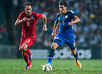 (R) Enzo Perez of Argentina  is followed by (L) Andy Naegelein of Hong Kong during the HKFA Centennial Celebration Match between Hong Kong vs Argentina at the Hong Kong Stadium on 14th October 2014 in Hong Kong, China. Photo by Aitor Alcalde / Power Sport Images