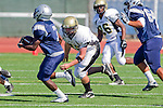 Torrance, CA 09/08/11 - Michael Pettis (Peninsula #75) and unidentified North players in action during the North-Peninsula Junior Varsity Football game at North High School in Torrance.