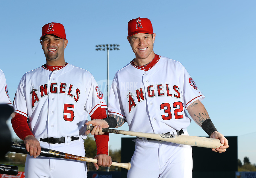 Feb. 20, 2013; Tempe, AZ, USA: Los Angeles Angels first baseman Albert Pujols (left) and outfielder Josh Hamilton pose for a portrait during photo day at Tempe Diablo Stadium. Mandatory Credit: Mark J. Rebilas-
