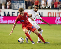 KANSAS CITY, KS - JUNE 26: Djordje Mihalovic #20 attacks past Marcos Sanchez #8 during a game between Panama and USMNT at Children's Mercy Park on June 26, 2019 in Kansas City, Kansas.