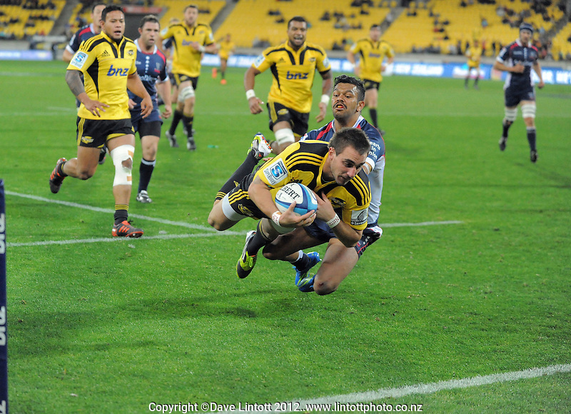Andre Taylor scores for the Hurricanes during the Super 15 rugby match between the Hurricanes and Rebels at Westpac Stadium, Wellington, New Zealand on Saturday, 26 May 2012. Photo: Dave Lintott / lintottphoto.co.nz