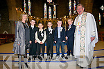 CBS Dingle pupils Muiris O? Su?illeabhain, Stephen O? Grifi?n, Jack Bric, Oliver Mac Gearailt and Fionn Crandall with their teacher Ro?isi?n Ui? Bheaglaoi and fr. Looney the day of their First Communion at St. Mary's Church, Dingle, on Saturday.