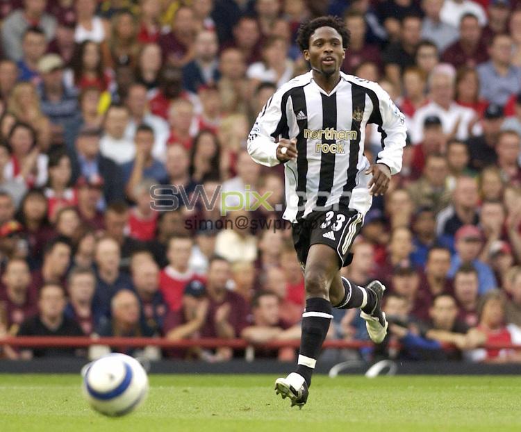 Pix Daniel Hambury/SWpix.com. Football. Premier League Soccer. Season 2005-2006. 14/08/2005. Arsenal v Newcastle United...COPYRIGHT PICTURE>>SIMON WILKINSON - SWpix.com>>07811 267 706>>..Newcastle United's Celestine Babayaro running with the ball.