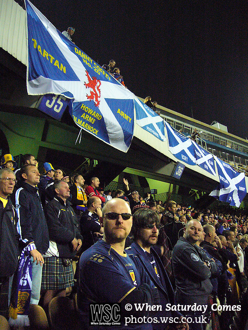 Ukraine 2 Scotland 2, 11/10/2006. Olympic Stadium, Euro 2008 Qualifying. Scotland fans, members of the Tartan Army, watch their team's match against Ukraine. Ukraine defeated Scotland 2-0 after a goal-less first half in this Euro 2008 group qualifying match played at the Olympic Stadium in Kyiv (Kiev). This was the first competitive international match between the countries. Photo by Colin McPherson.