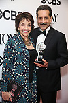 Brooke Adams and Tony Shalhoub pose in the 72nd Annual Tony Awards Press Room at 3 West Club on June 10, 2018 in New York City.