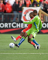 Steve Zakuani (11) of the Seattle Sounders FC and Marvell Wynne (16) of Toronto FC in MLS action at BMO Field on April 4, 2009.Seattle won 2-0.