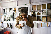 Rajah Banerjee, the owner of Makaibari Tea Estate, tastes and inhales the aroma of various types of teas at the Makaibari Tea estate, in Darjeeling, India