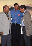 Earl Woods, Tiger Woods and Bryant Gumbel attend the Tiger Woods Foundation Benefit Auction at the All Star Cafe on on June 16, 1997 in New York City.