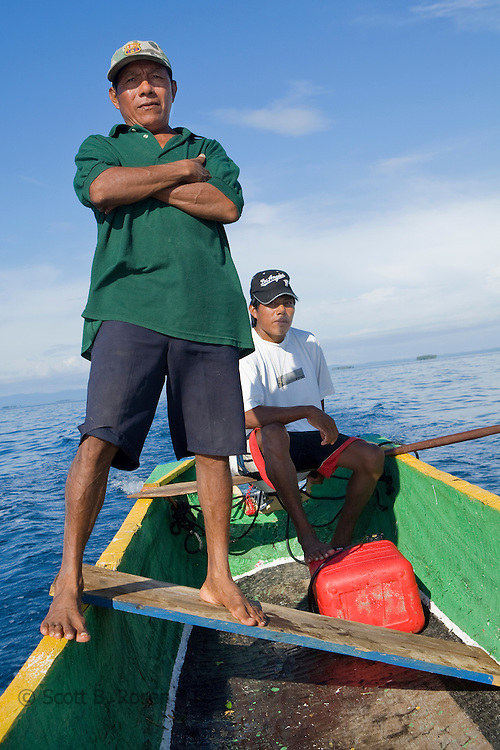 "Two Kuna Yala men on a Cayuko ""dug-out canoe"" transport locals and visitors through the San Blas Islands, Panama"