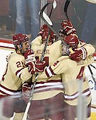 Steven Whitney (BC - 21), Pat Mullane (BC - 11), Patch Alber (BC - 3) and Teddy Doherty (BC - 4) celebrate with Gaudreau - The Boston College Eagles defeated the visiting Northeastern University Huskies 3-0 after a banner-raising ceremony for BC's 2012 national championship on Saturday, October 20, 2012, at Kelley Rink in Conte Forum in Chestnut Hill, Massachusetts.