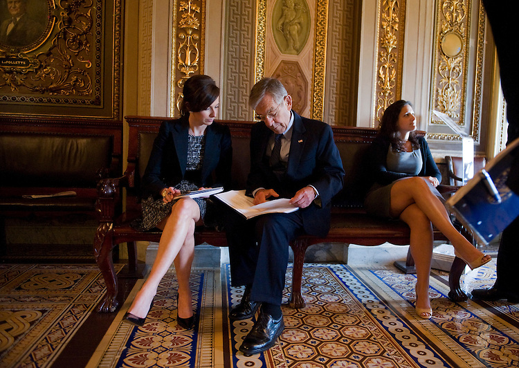 UNITED STATES - SEPTEMBER 28: Sen. George Voinovich, R-Ohio, talks with an aide in the Senate reception Room after a vote.  (Photo By Tom Williams/Roll Call via Getty Images)