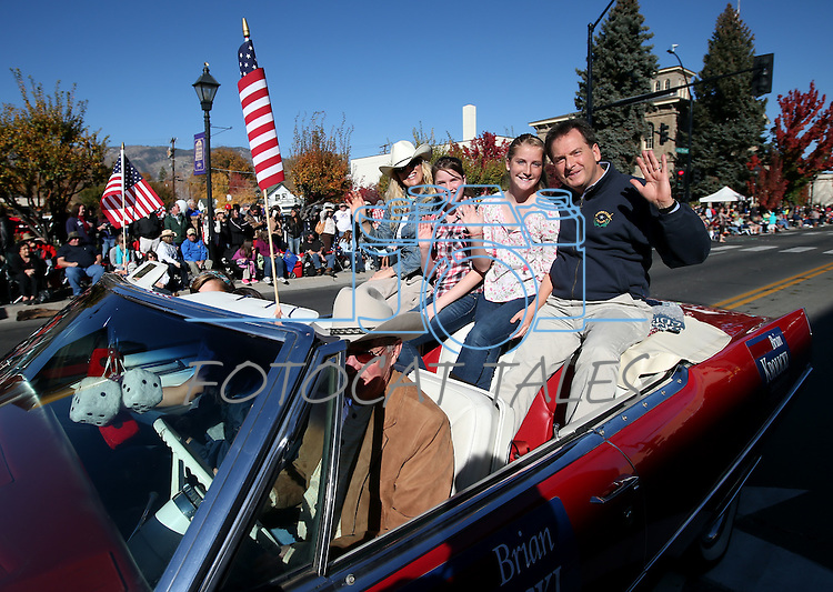 Nevada Lt. Gov. Brian Krolicki and his family ride in the 75th annual Nevada Day parade in Carson City, Nev., on Saturday, Oct. 26, 2013.<br /> Photo by Cathleen Allison