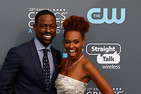 Sterling K. Brown and Ryan Michelle Bathe (r) attend the 23rd Annual Critics' Choice Awards at Barker Hangar in Santa Monica, Los Angeles, USA, on 11 January 2018. Photo: Hubert Boesl - NO WIRE SERVICE - Photo: Hubert Boesl/dpa /MediaPunch ***FOR USA ONLY***