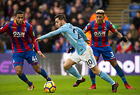 Bernardo Silva of Manchester City takes on Jairo Riedewald (44) & Patrick van Aanholt of Crystal Palace during the Premier League match between Crystal Palace and Manchester City at Selhurst Park, London, England on 31 December 2017. Photo by Andy Rowland.