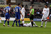 ATTENTION SPORTS PICTURE DESK<br /> Pictured: Jason Scotland of Swansea injured on the ground surrounded by S W Mathieson referee and other players.<br /> Re: Coca Cola Championship, Swansea City FC v Doncaster Rovers at the Liberty Stadium. Swansea, south Wales, Saturday 21 February 2009<br /> Picture by D Legakis Photography / Athena Picture Agency, Swansea 07815441513