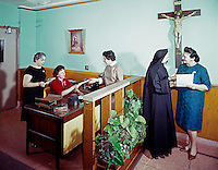 Providence Rest Nursing home, NYC, New York, Nun and aids talking in the lobby