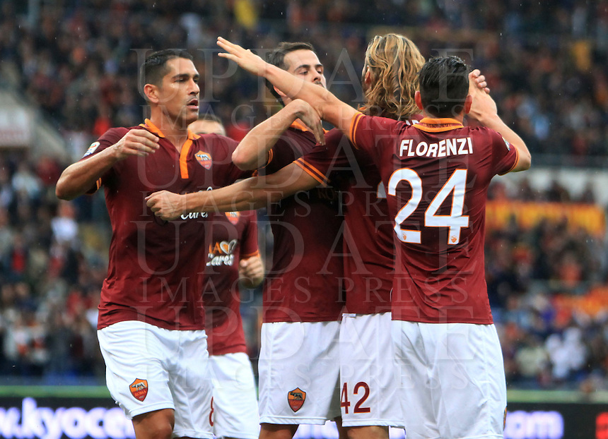 Calcio, Serie A: Roma vs Sassuolo. Roma, stadio Olimpico, 10 novembre 2013.<br /> From left, AS Roma's Marco Borriello, Miralem Pjanic, Federico Balzaretti and Alessandro Florenzi celebrate after Sassuolo defender Alessandro Longhi, not seen, scored an own goal during the Italian Serie A football match between AS Roma and Sassuolo at Rome's Olympic stadium, 10 November 2013. <br /> UPDATE IMAGES PRESS/Isabella Bonotto