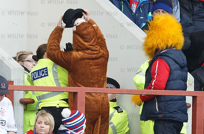 Honey Monster's monkey pal removes the hat from an unsuspecting WPC on the way out of the stadium but decides it doesn't make a good look with his outfit