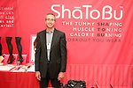 Mitch Brown, President of ShaTobBu poses in his booth during the CURVENY Designer Lingerie & Swim show, at the Jacob Javits Convention Center, August 3, 2010.