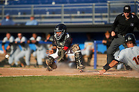 Batavia Muckdogs catcher Pablo Garcia (7) waits for a throw as Chris Harvey (10) slides home safely with umpire John Budka looking on during a game against the West Virginia Black Bears on August 21, 2016 at Dwyer Stadium in Batavia, New York.  West Virginia defeated Batavia 6-5. (Mike Janes/Four Seam Images)