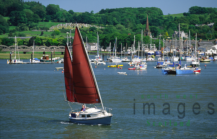Small yacht on the River Dee leaving Kirkcudbright Harbour Galloway Scotland UK