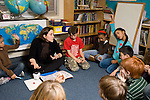Education Elementary School New York Grade 3 circle time on rug with female teacher talking to class horizontal