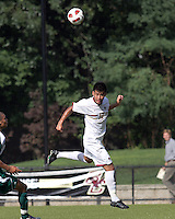 Boston College defender/forward Kevin Mejia (12) heads the ball. Boston College defeated George Mason University, 3-2, at Newton Soccer Field, August 26, 2011.