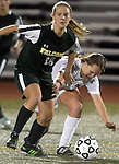(Worcester Ma 111513)  Minnechaug 18, Marissa Falcetti, and Newton North 23, Amelia Williams, in hot pursuit of the ball, during the MIAA State Girls Soccer Division 1 final, Friday, at Worcester State College in Worcester. (Jim Michaud Photo) For Saturday