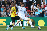 Tom Cleverley of Watford is challenged by Ki Sung-yueng of Swansea City during the Premier League match between Watford and Swansea City at Vicarage Road Stadium, Watford, England, UK. Saturday 15 April 2017