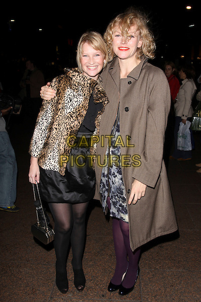 "JOANNA PAGE & MAXINE PEAKE.Leaving the UK Premiere of ""The Imaginarium Of Doctor Parnassus"" at the Empire Leicester Square, London, England.  .October 6th, 2009 .full length black layered layered top skirt tights shoes blue floral grey gray print dress zip scallop edged aubergine purple open toe ankle boots booties shoe shooboots leopard print jacket coat mac trenchcoat trench  .CAP/AH.©Adam Houghton/Capital Pictures."